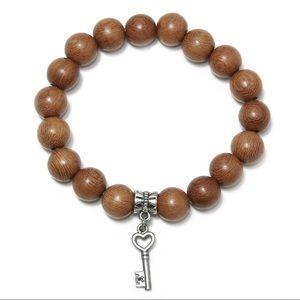 Jewelry - Wood bead bracelet with silver key charm